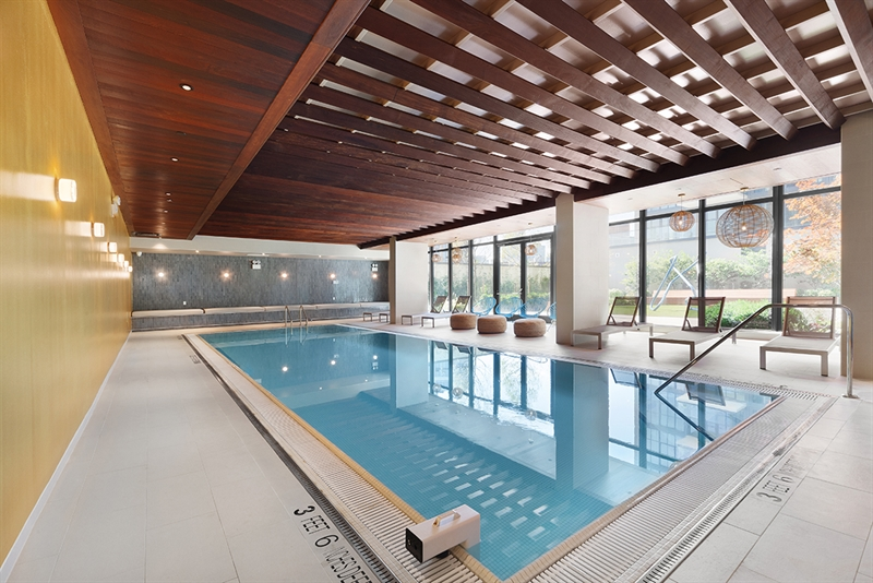 The indoor pool's double doors open to the beautifully landscaped courtyard.