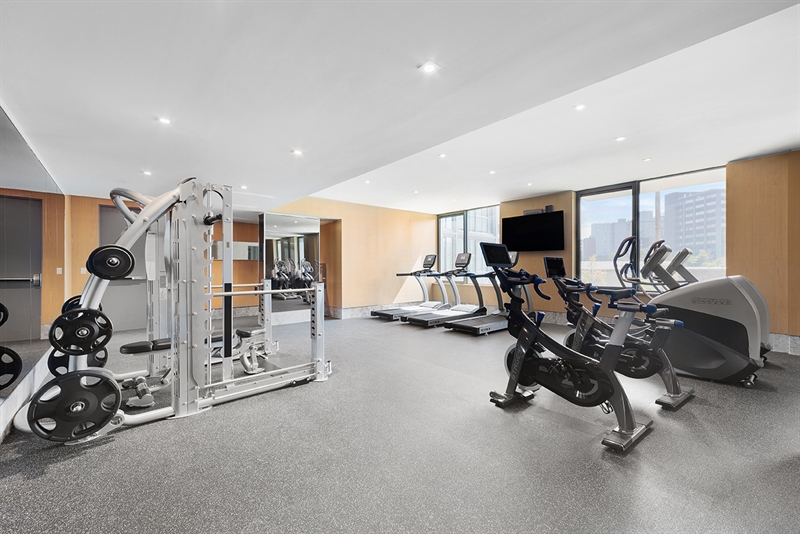 Perched on the second floor, the fitness center provides a bird's-eye view of the courtyard below.
