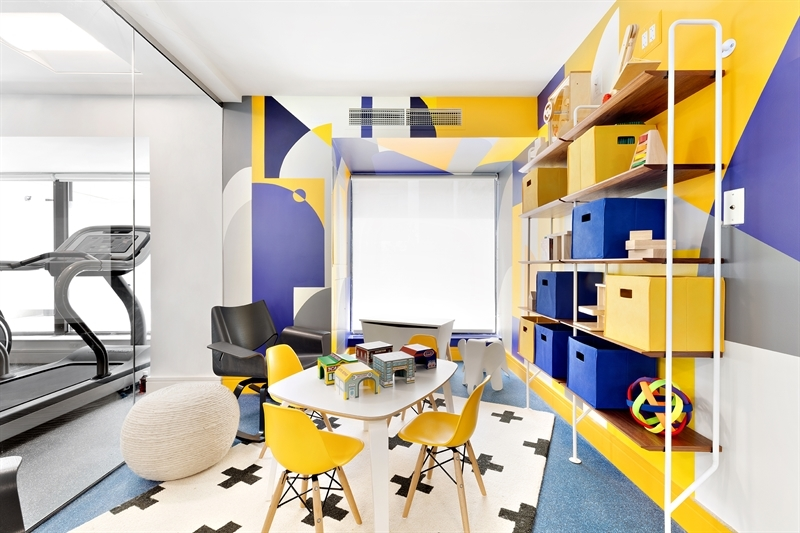 With a visual connection to the Fitness Room, the day lit Children's Playroom provides a play space outside the apartment for active and inquiring minds.