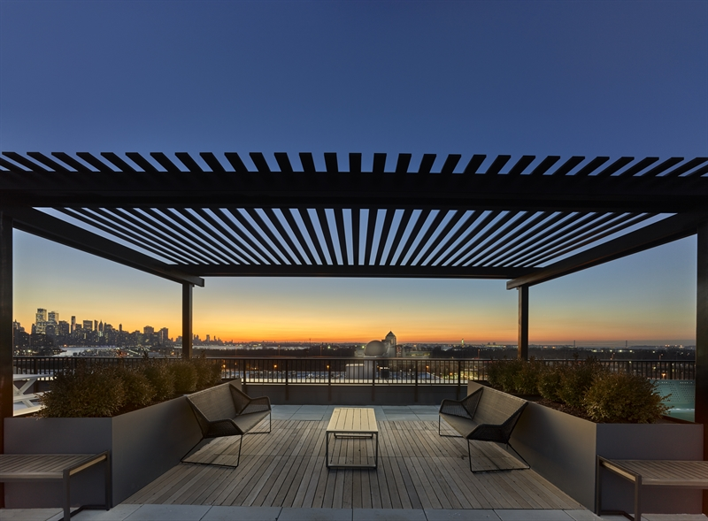 Perfect for entertaining, the rooftop terrace offers sweeping views of the NYC skyline and the Statue of Liberty.