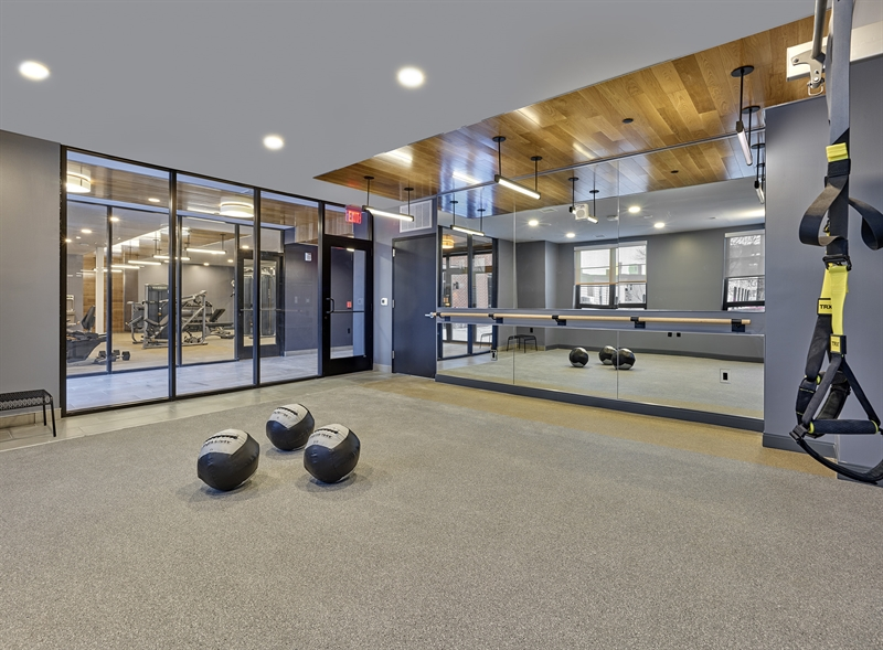 The fitness suite includes a studio for yoga, barre, and TRX.