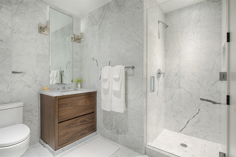 Contemporary styling brings the bathrooms to life. Carrara marble walls and floor tiles create a clean, crisp feeling of serenity.
