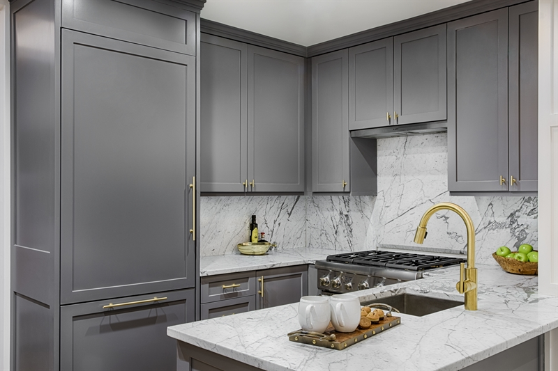 Custom designed kitchens feature natural stone countertops and appliances from Thermador and Bosch.
