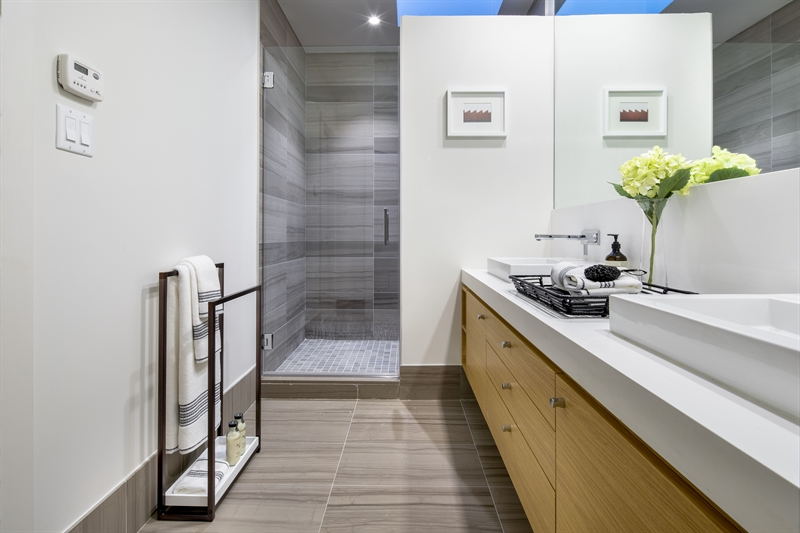 The master bathroom features Ashen Gray marble, radiant heated floors, custom double vanity and Hansgrohe fixtures.