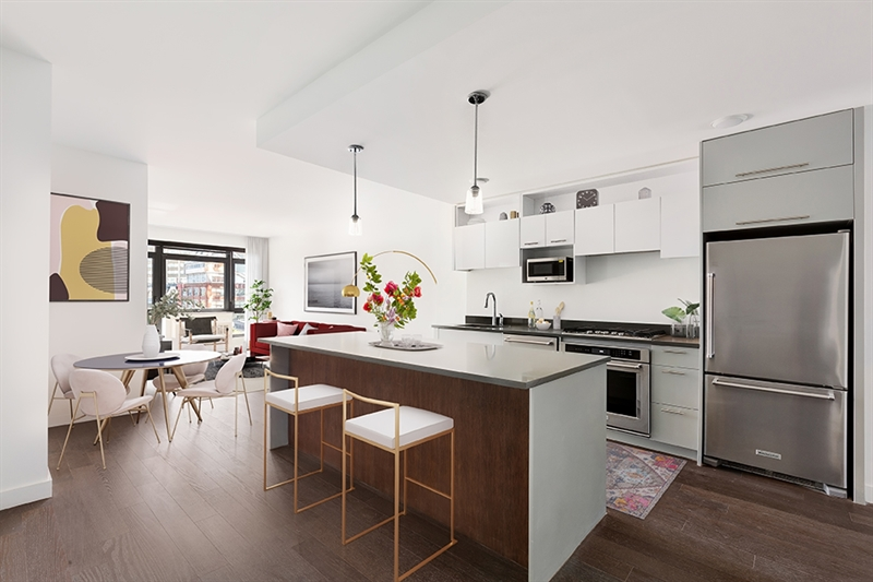 The kitchens feature a suite of stainless steel appliances and Caesarstone countertops